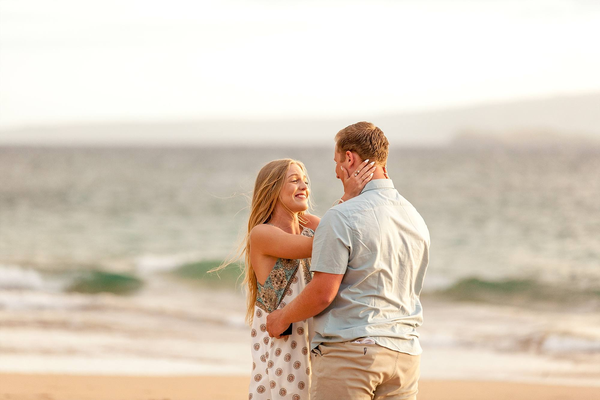 newly engaged couple just after proposal and woman smiling at her now fiance