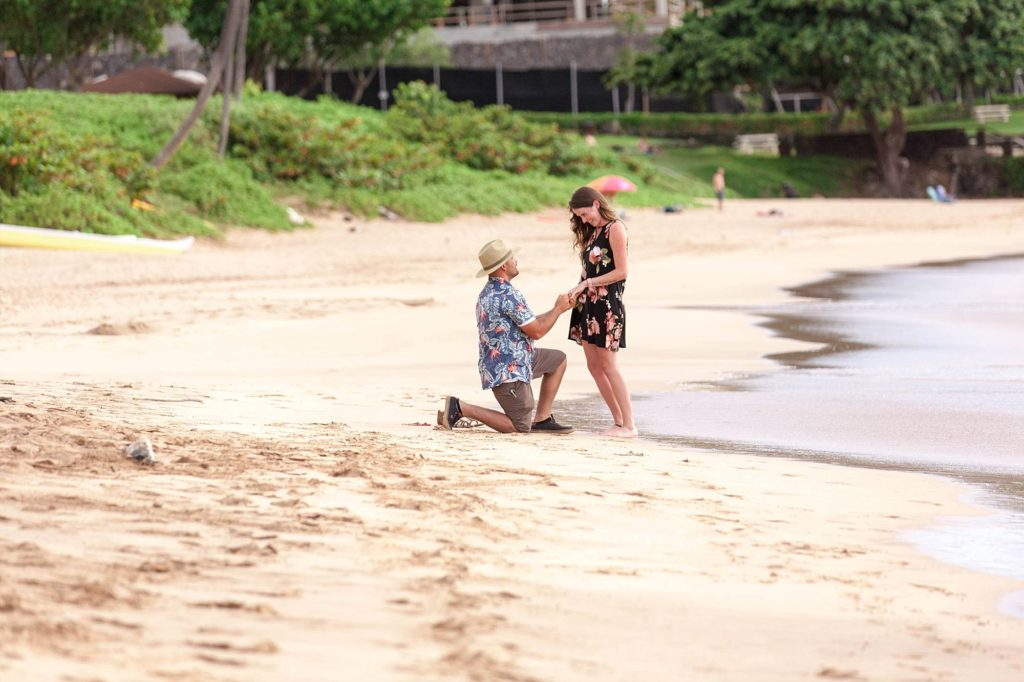 couple getting engaged on gorgeous maui beach