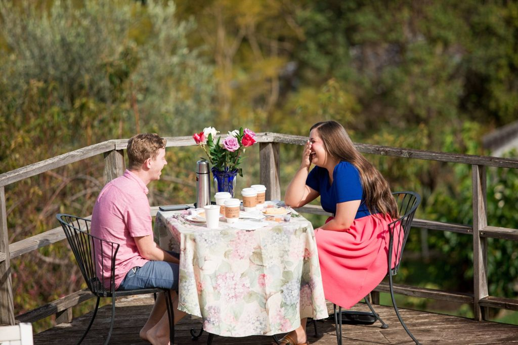a sweet date captured with man and woman sitting on a private deck overlooking all of Maui, at the lavender farm