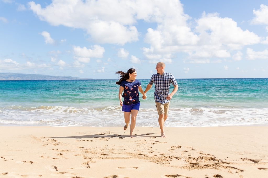 Couple running on Maui beach
