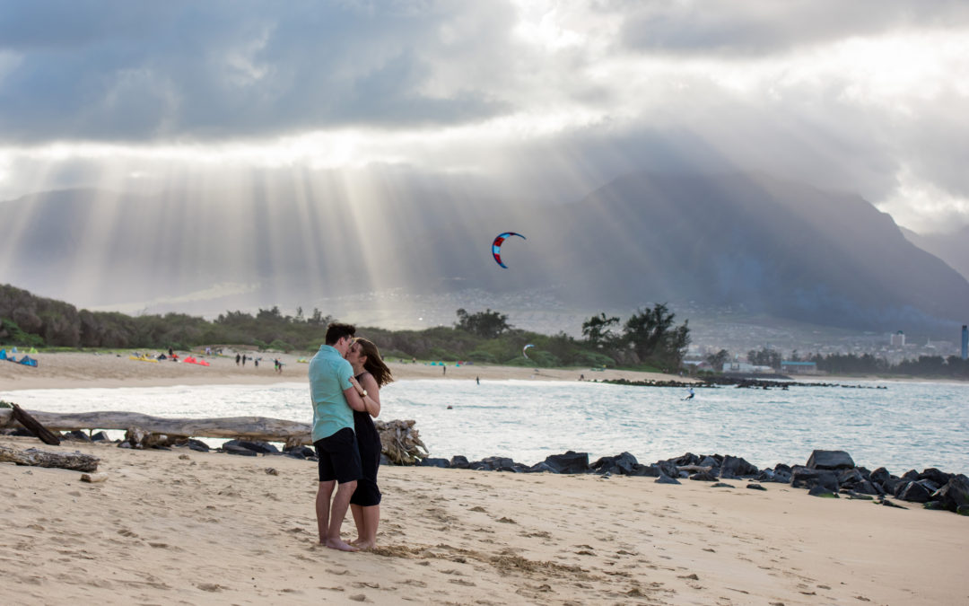 couple hugging during beach proposal
