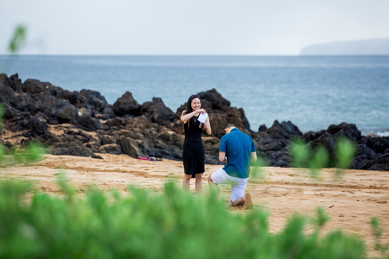 surprise proposal on beach with message in a bottle