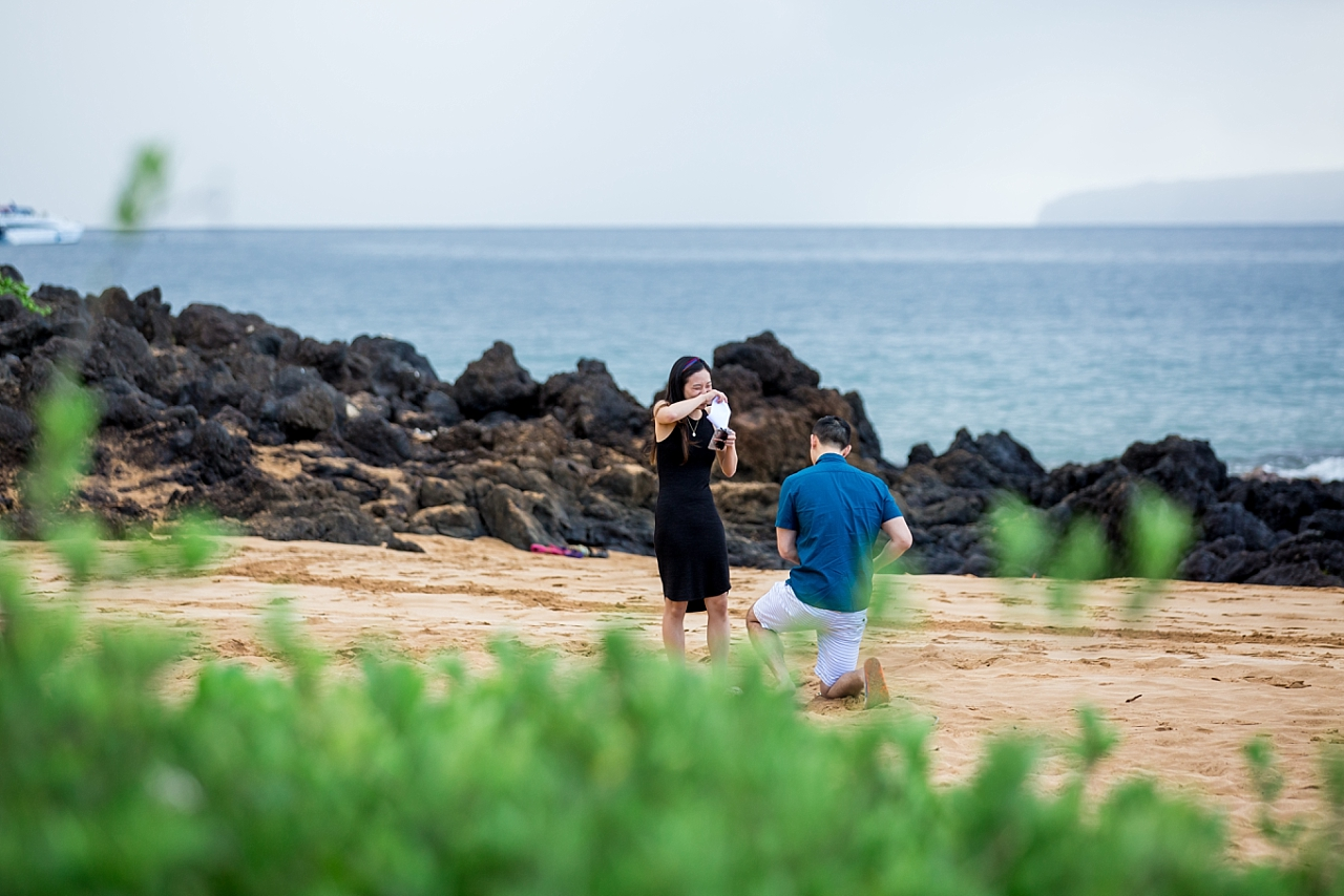 woman surprised on secluded beach proposal