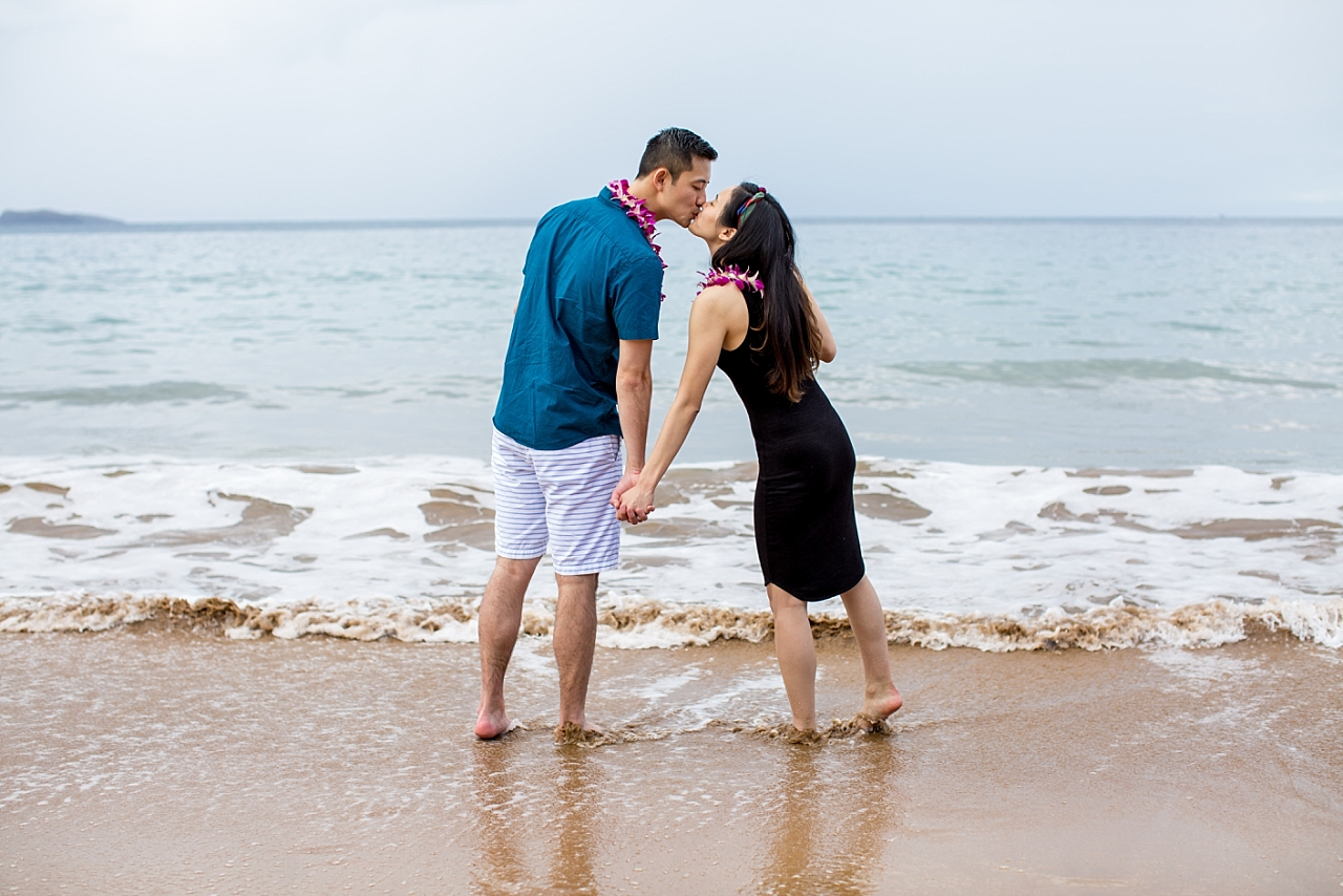 couple kissing on secluded maui beach
