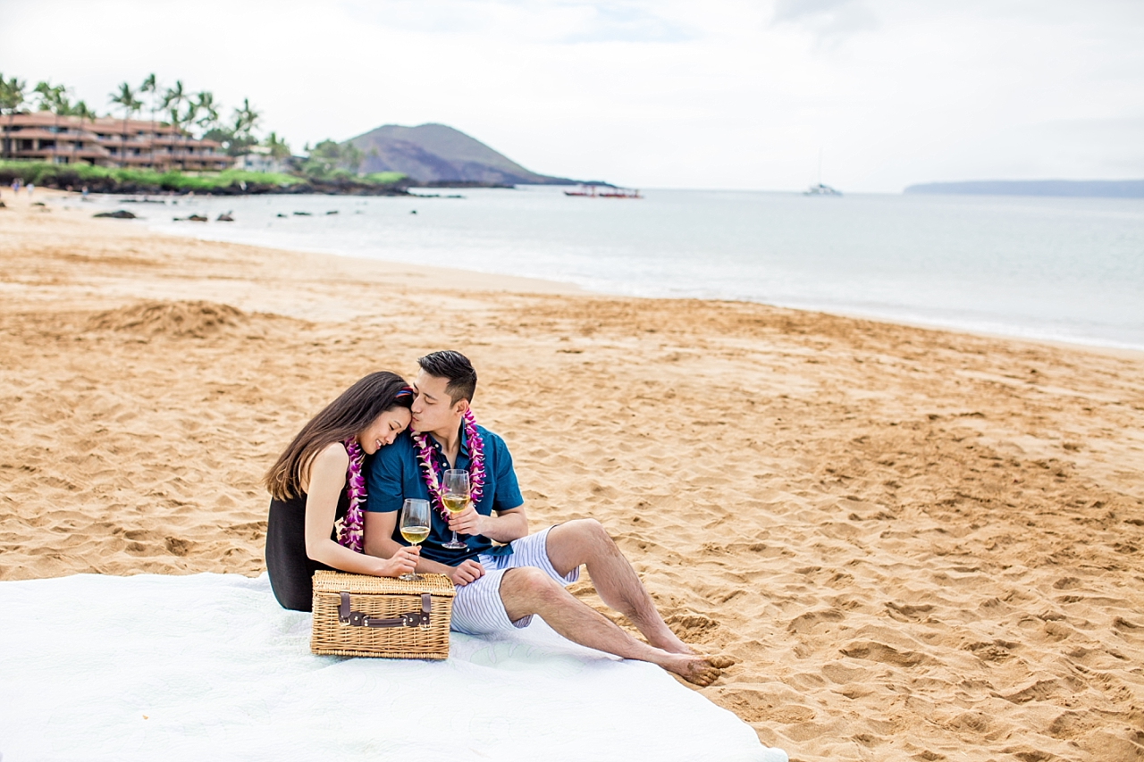 couple on secluded beach picnic in maui