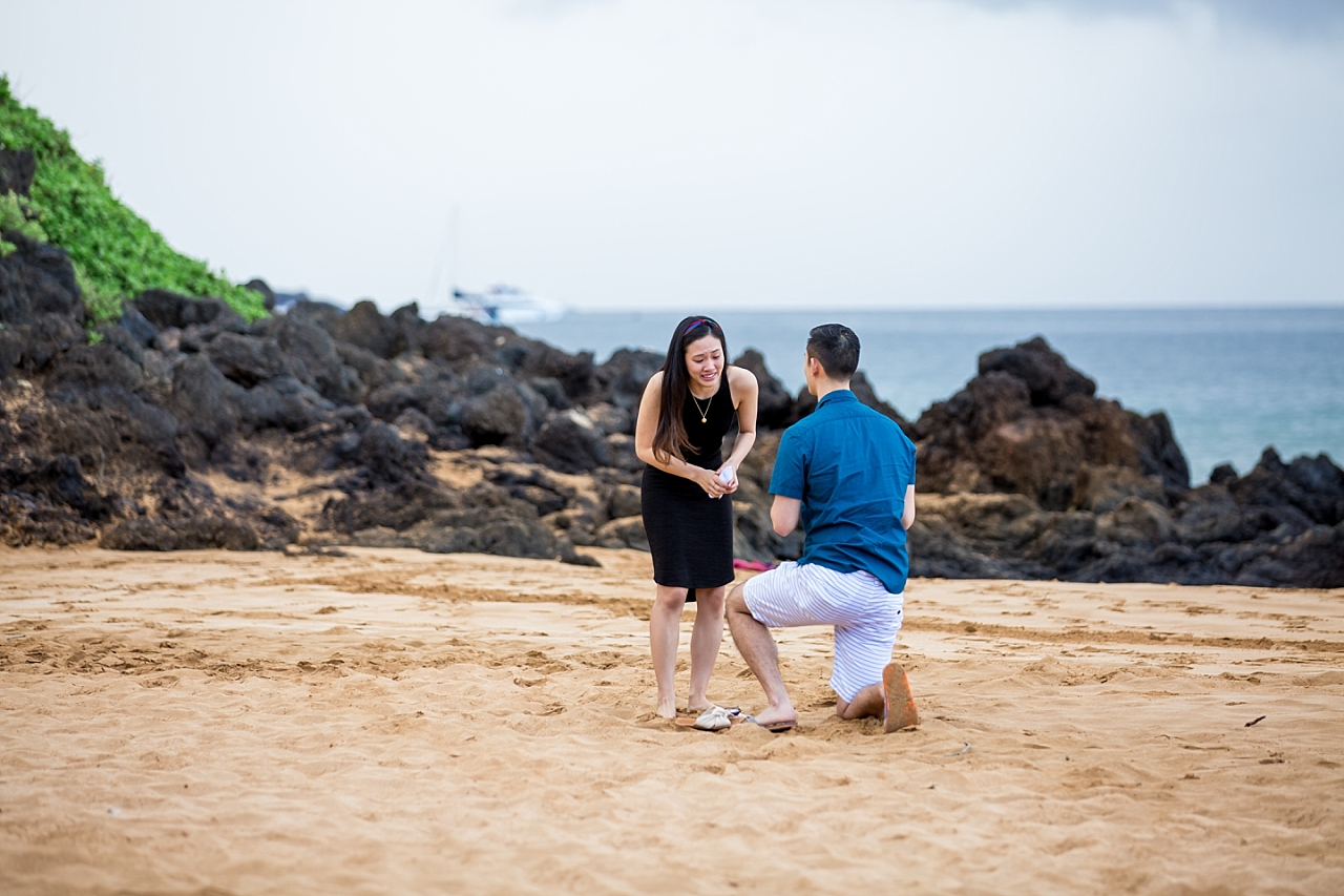 man goes down on one knee for surprise secluded beach proposal