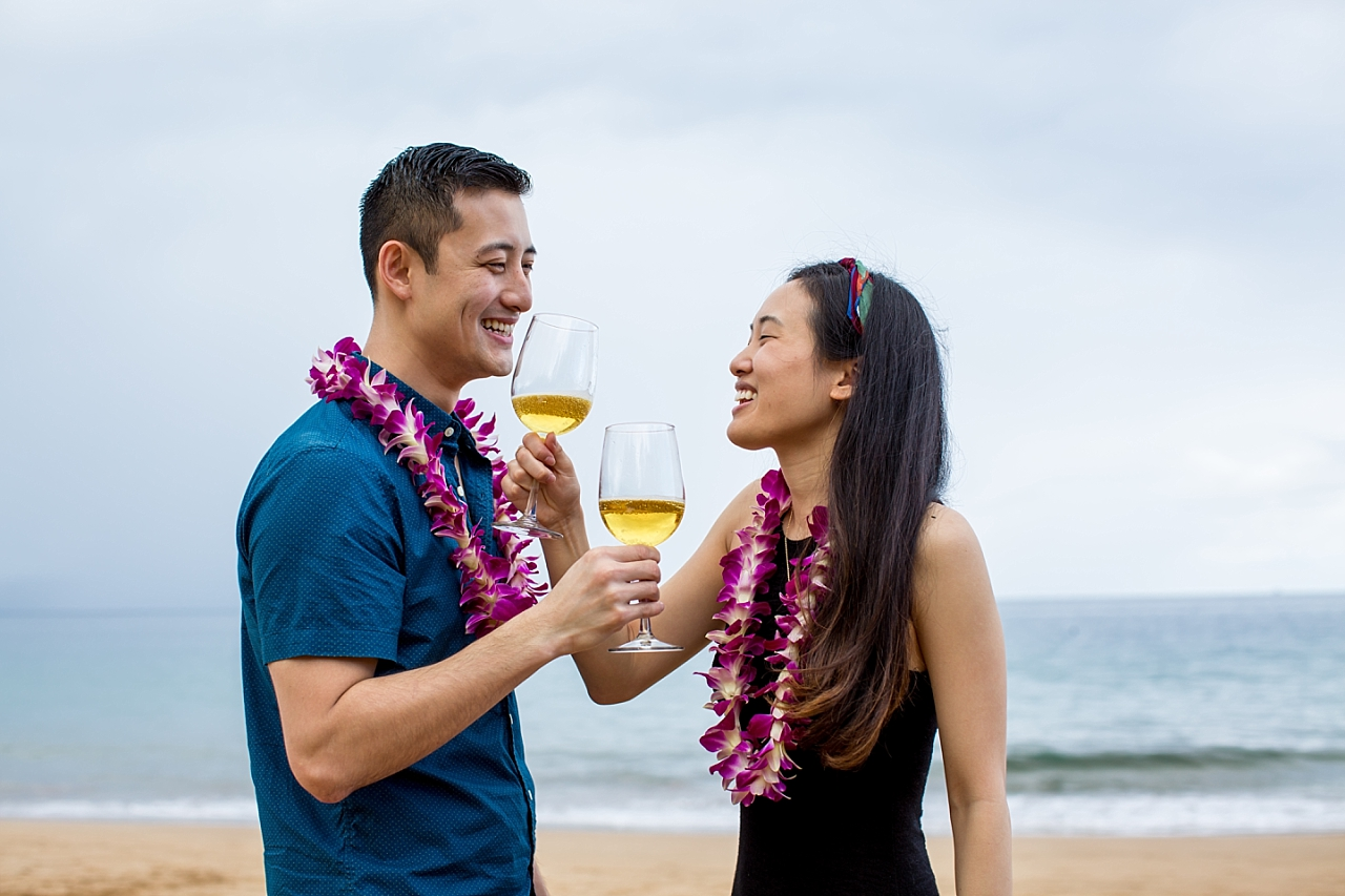 couple toasting each other after beach proposal after proposal