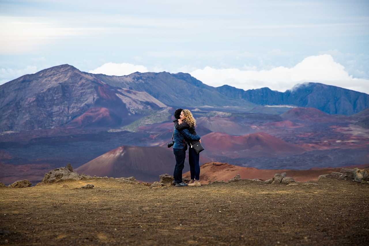 engaged couple hugging at Haleakala Crater Proposal