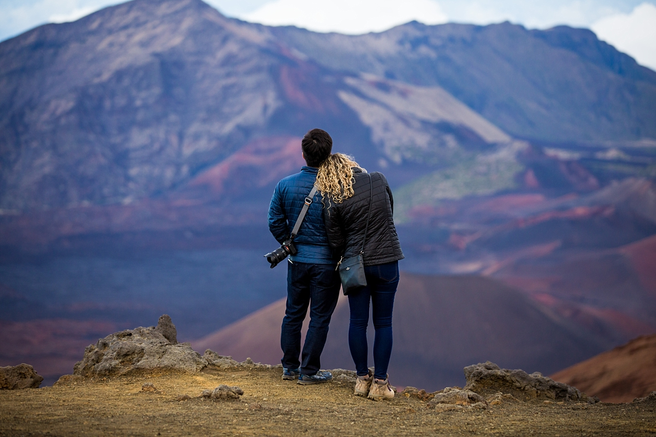 engaged couple taking in the view at Haleakala Crater