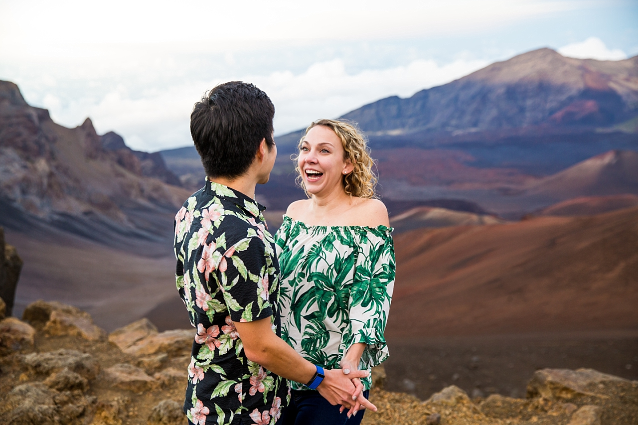 engaged couple laughing at Haleakala Crater Proposal