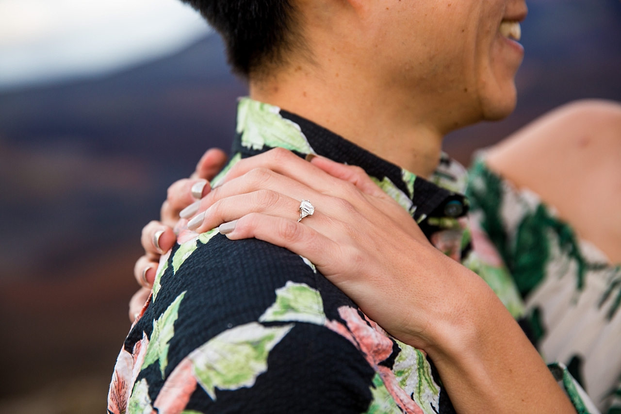 engaged couple embracing after maui engagedment