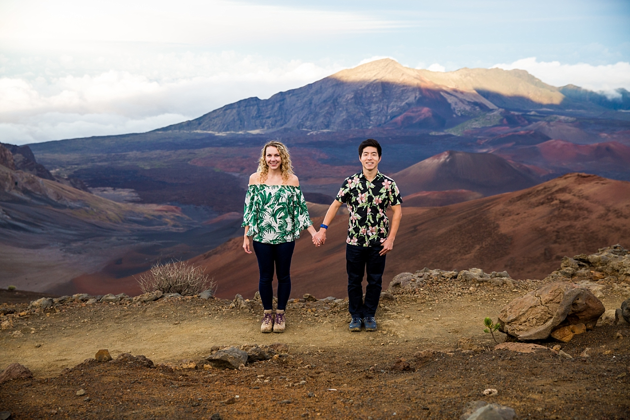 engaged couple holding hands at Haleakala Crater summit