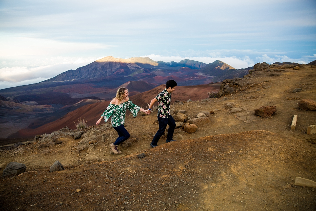 engaged couple walking hand in hand on Haleakala Crater summit
