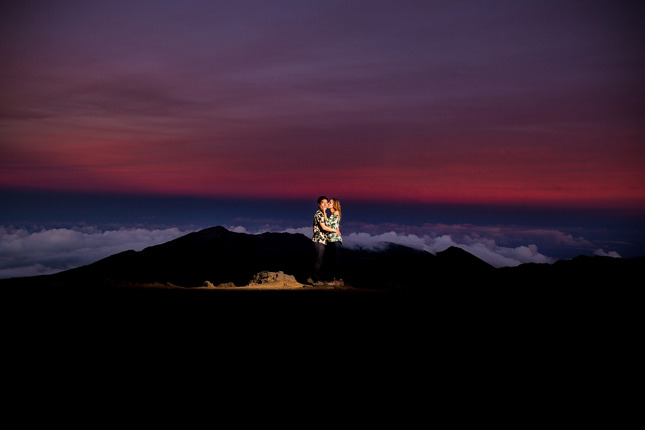 engaged couple snuggling during Haleakala Crater Proposal sunset