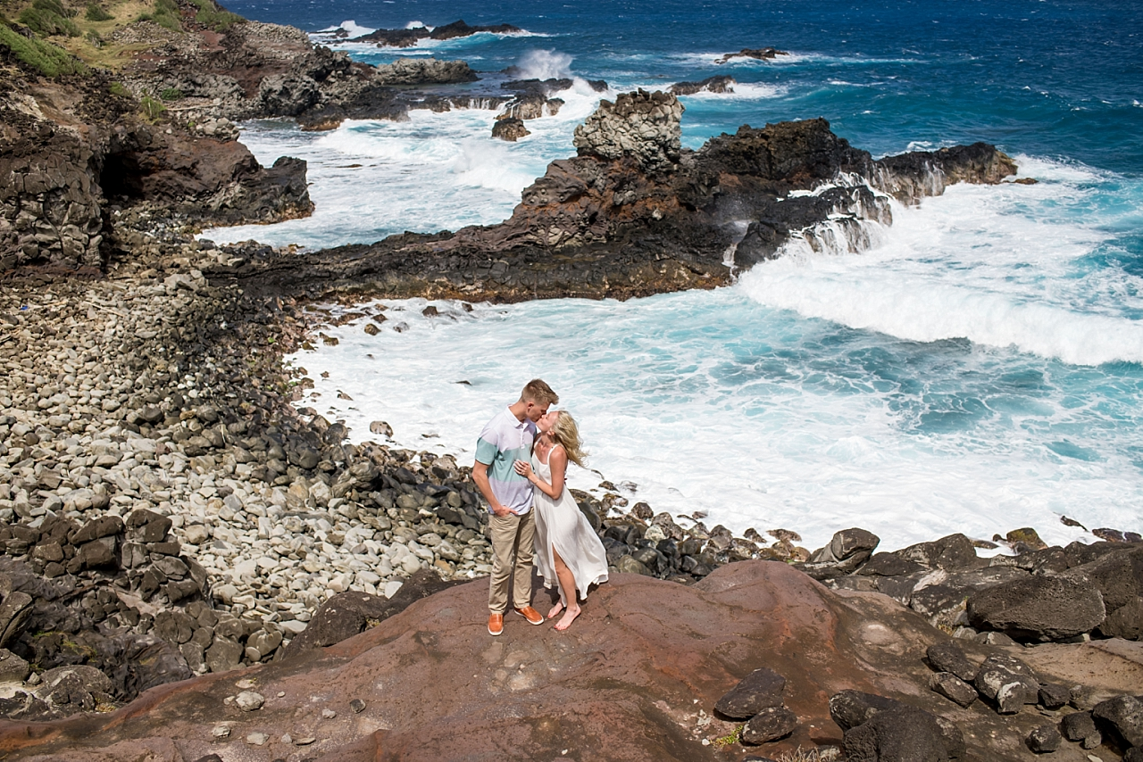 couple celebrates engagement on maui rock beach