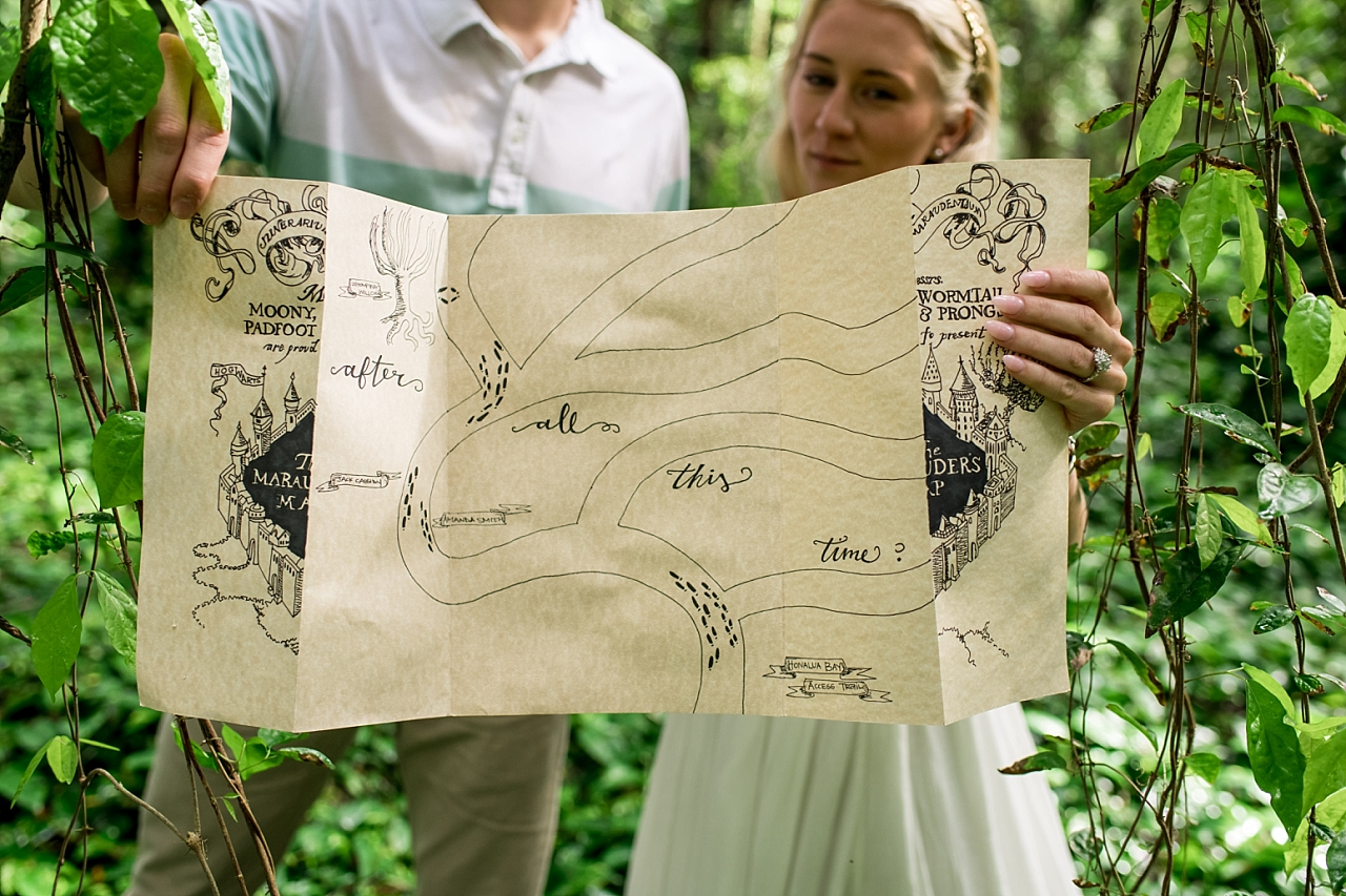 couple holding map at harry potter scavenger hung