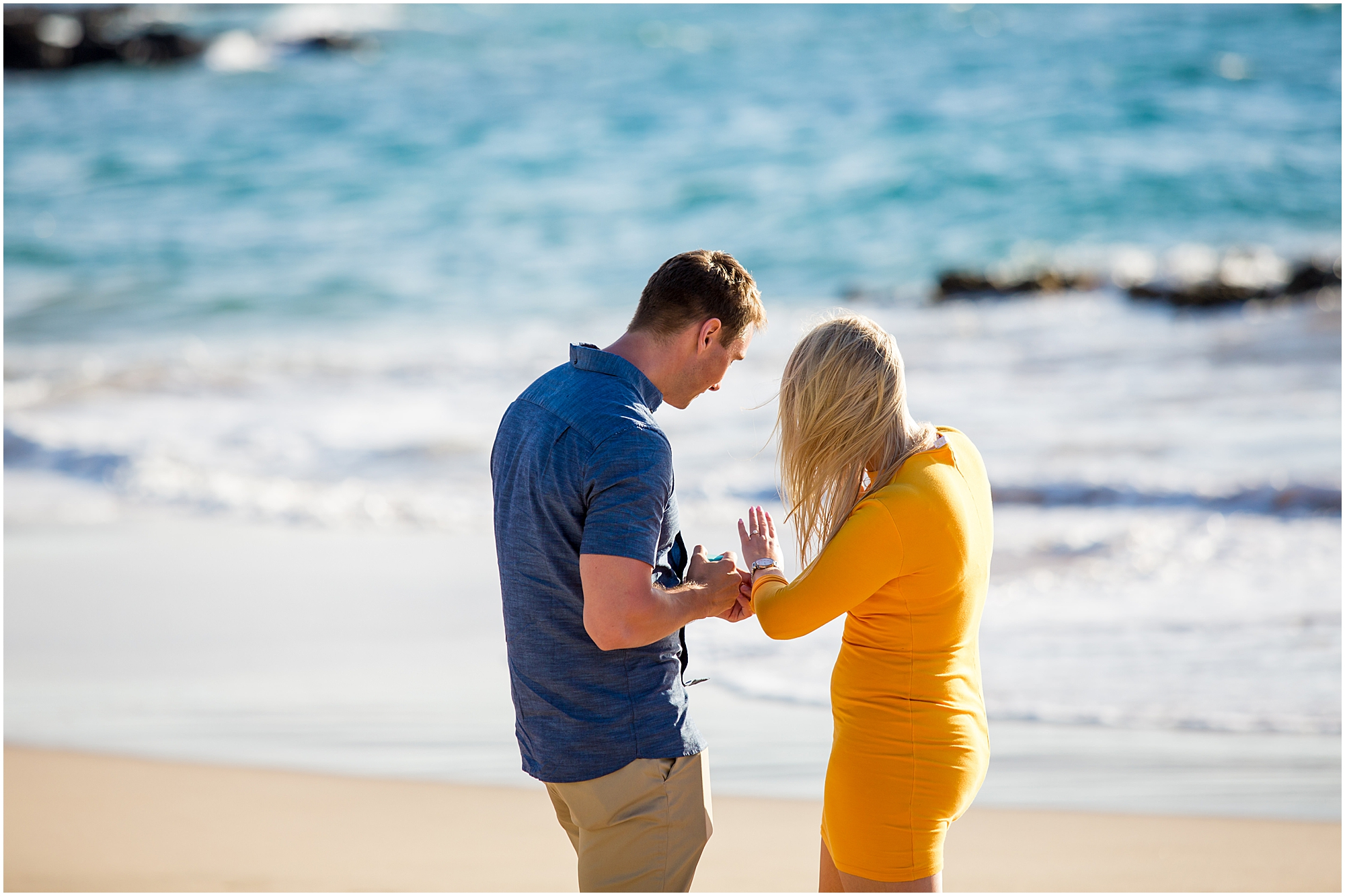 couple admires engagement ring after proposal