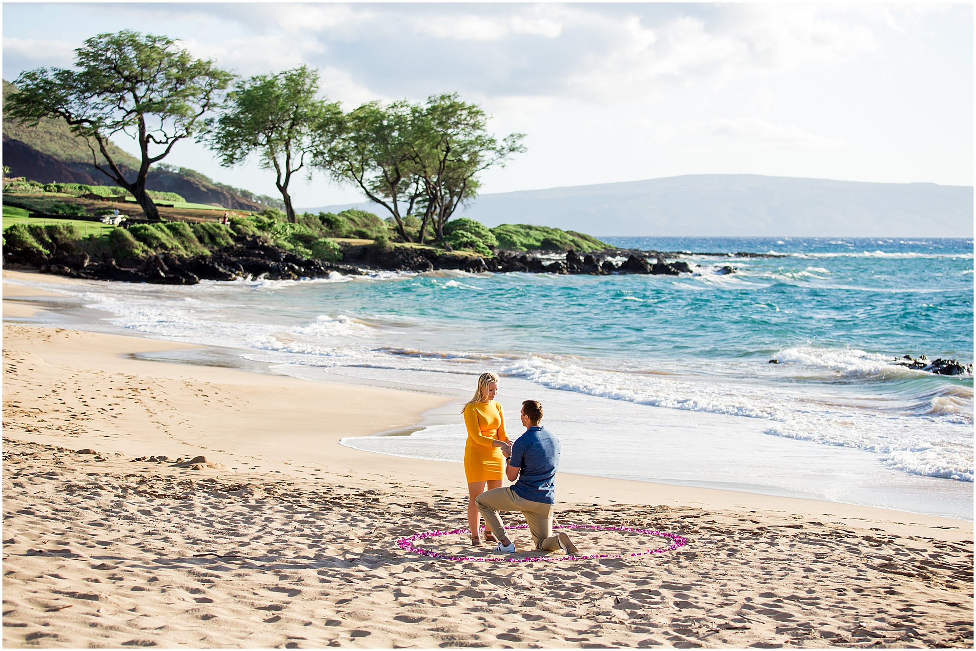 Maui proposal on the beach with ocean and greenery