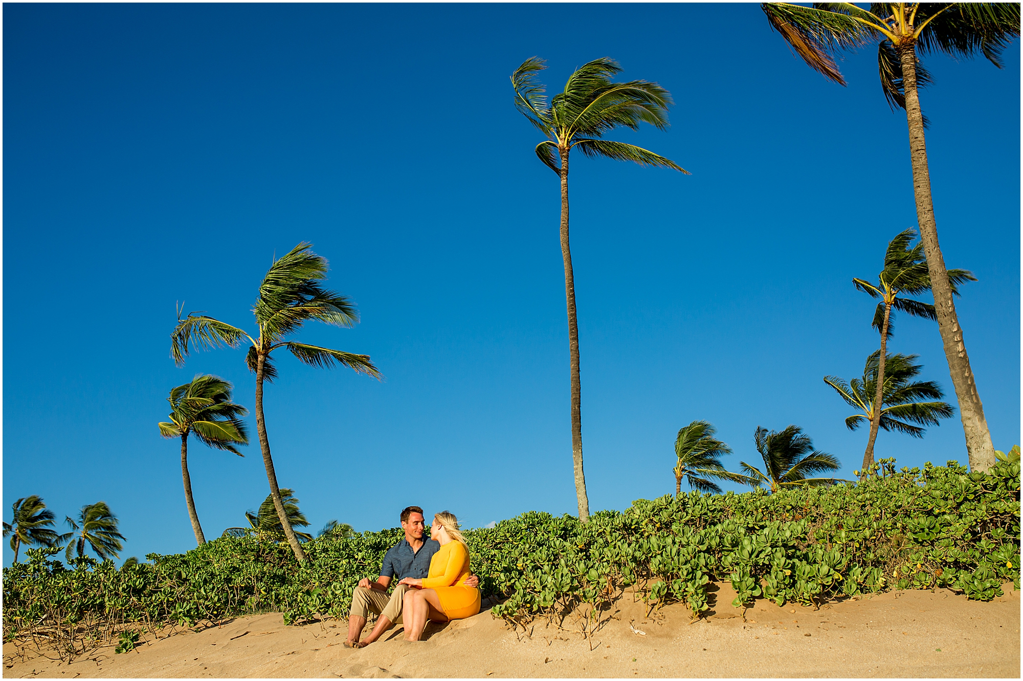 couple sitting among the Maui palm trees