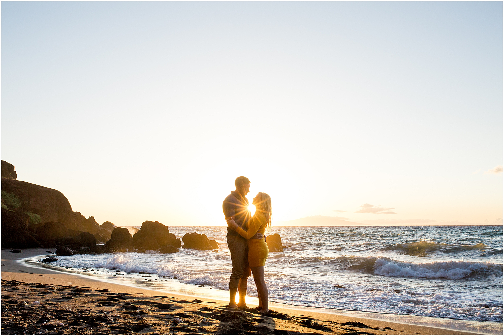 Maui engagement photography among lava rocks