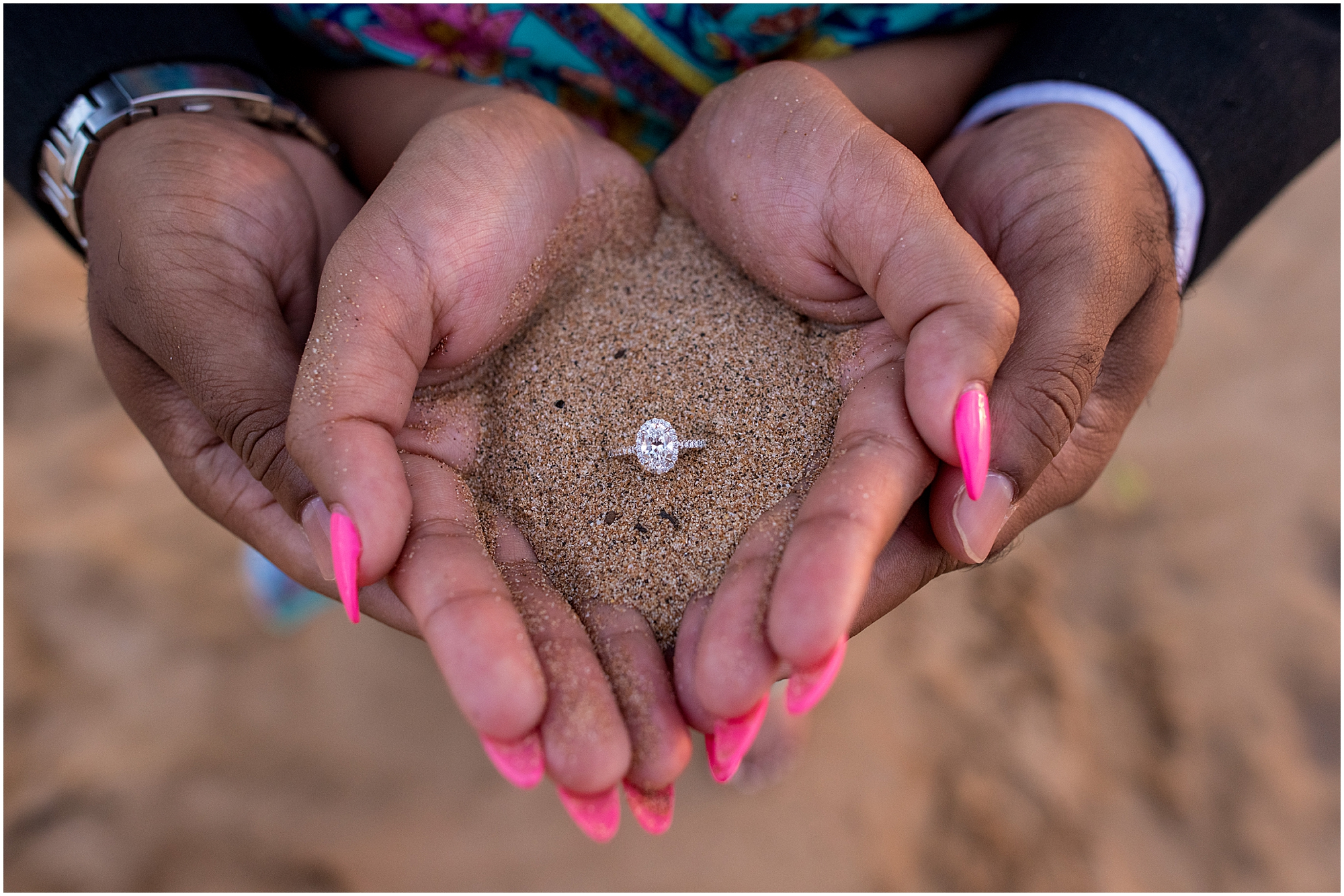 Engagement ring held in sand