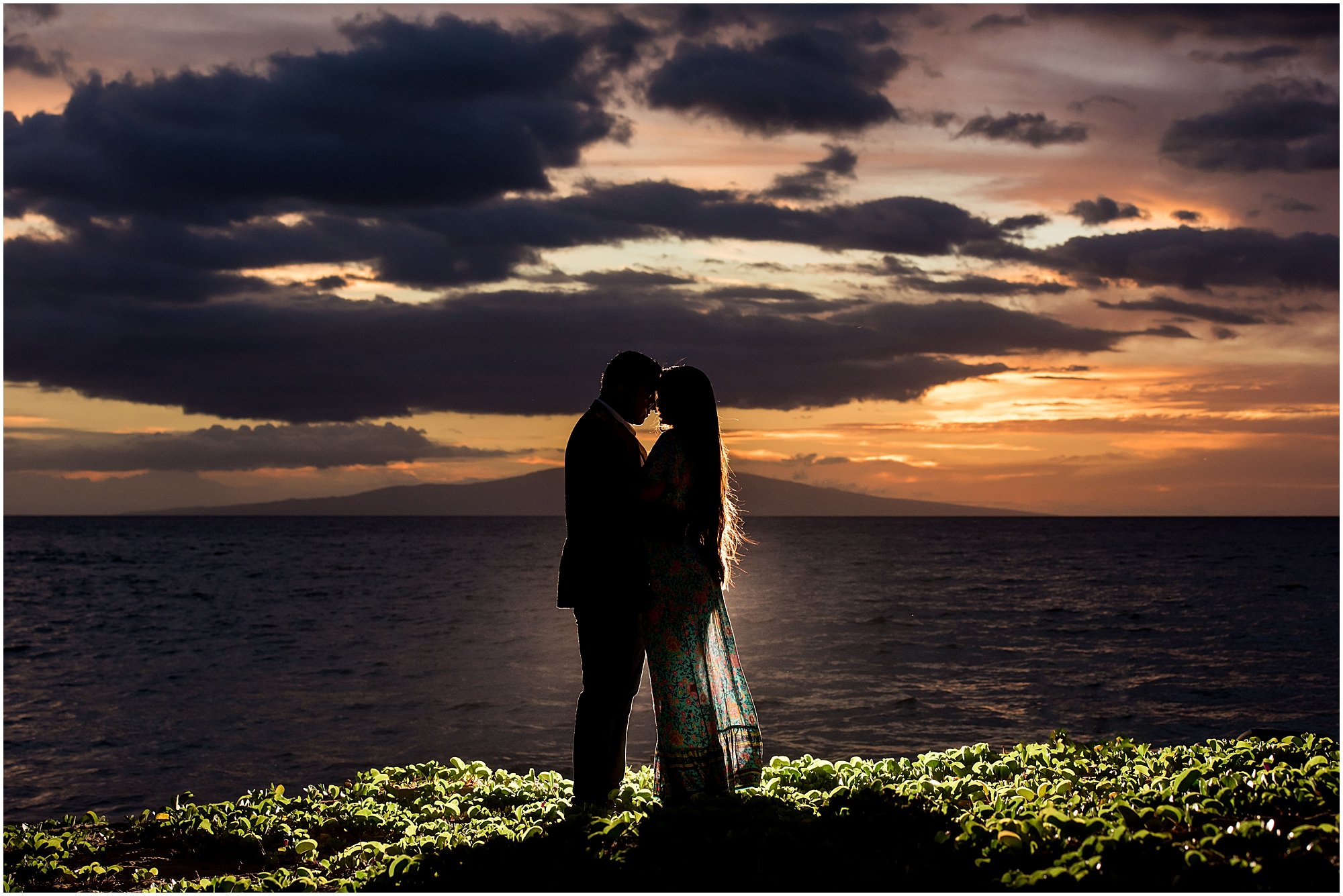 Couple during engagement session after sunset