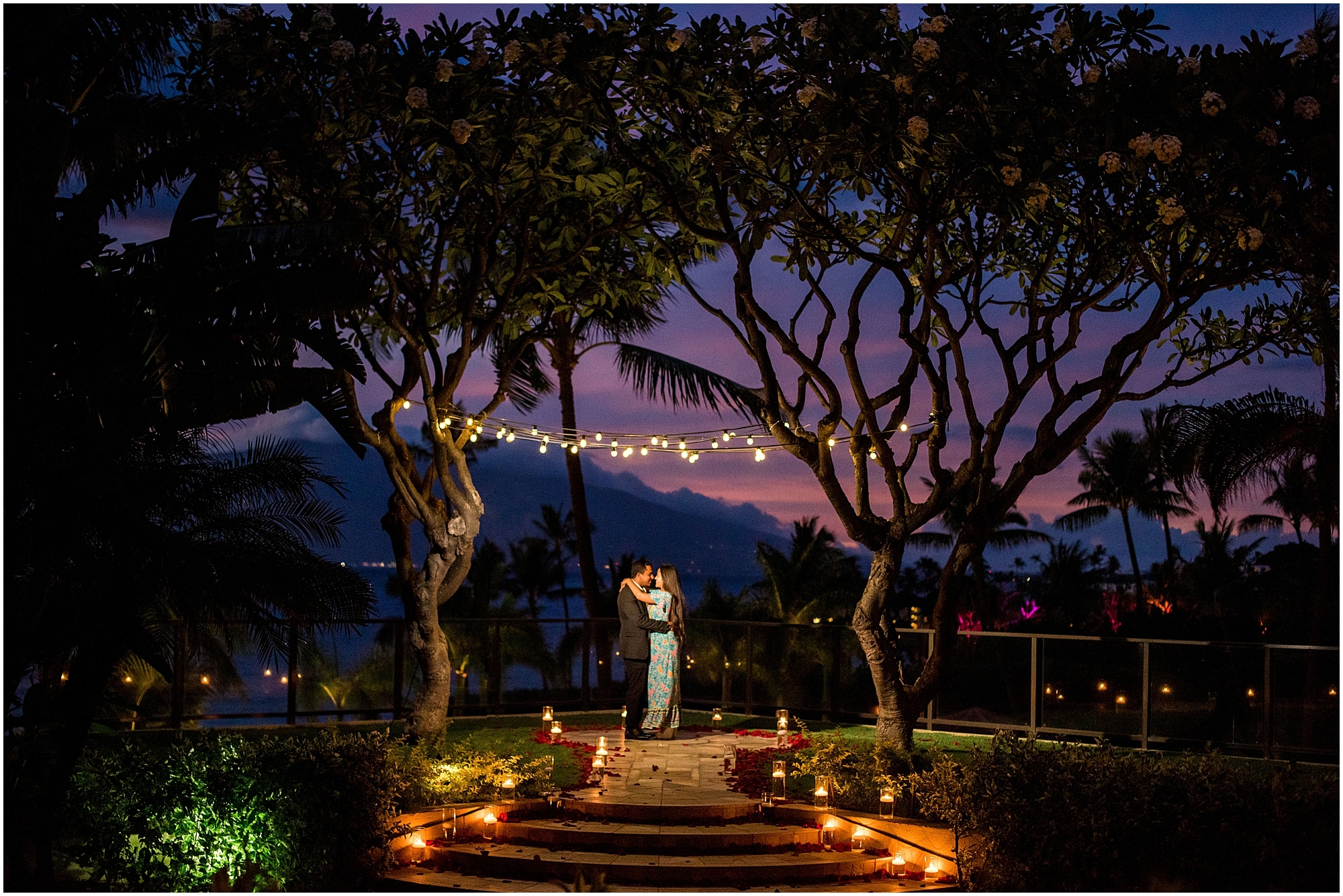 Couple at Four Seasons Maui Plumeria Point after proposal at night