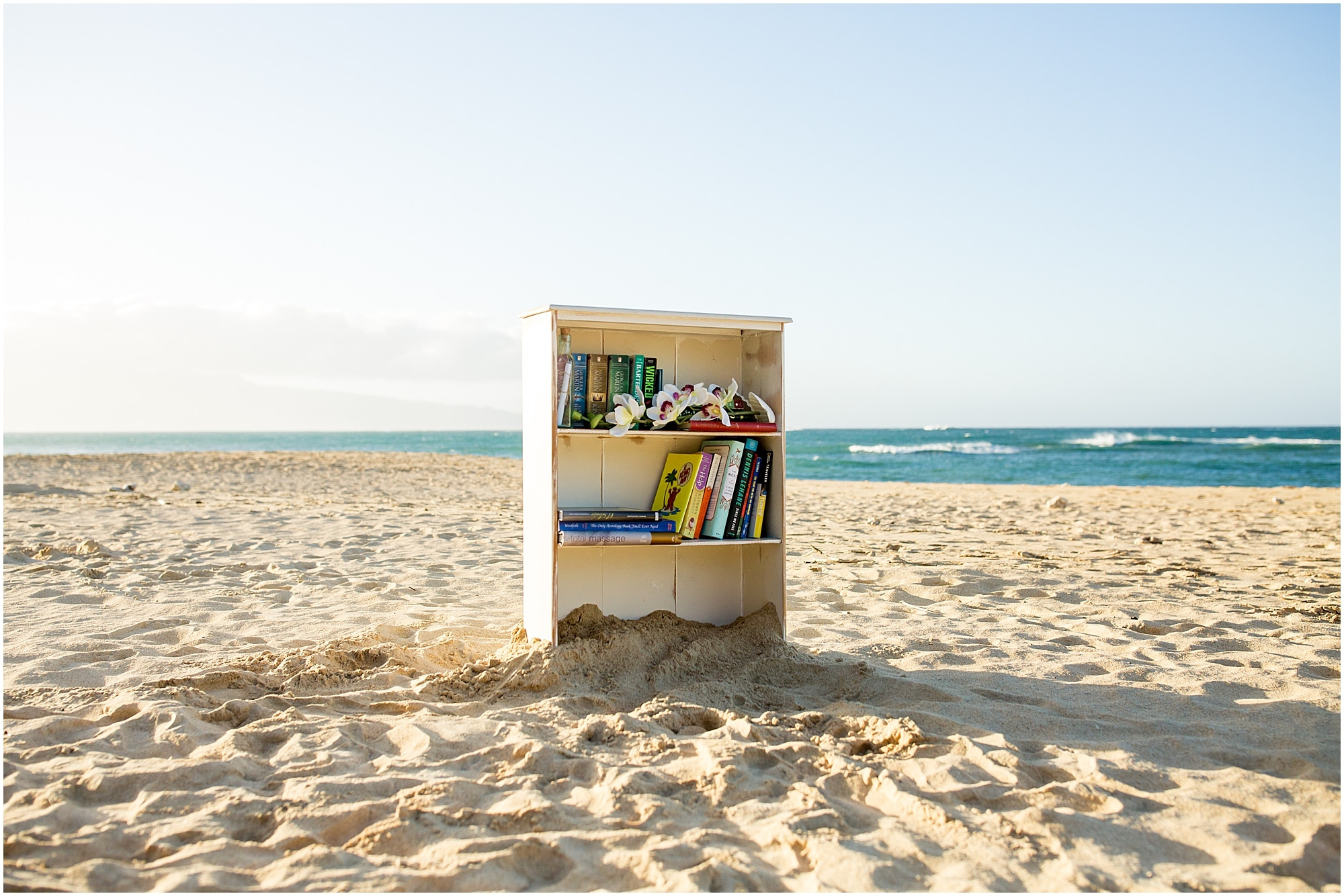 beach library set up for a surprise Maui proposal