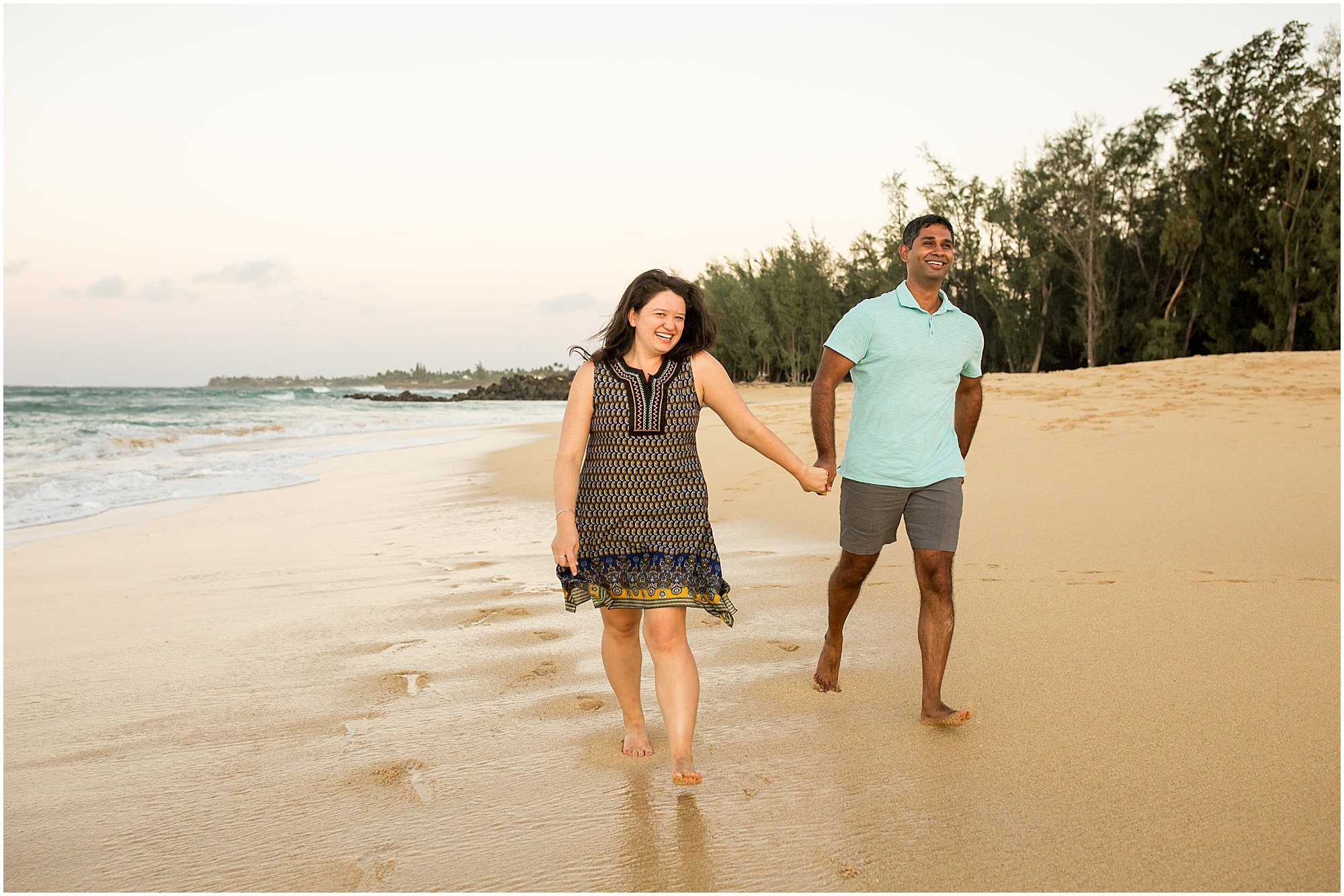 newly engaged couple stroll this north shore beach on Maui