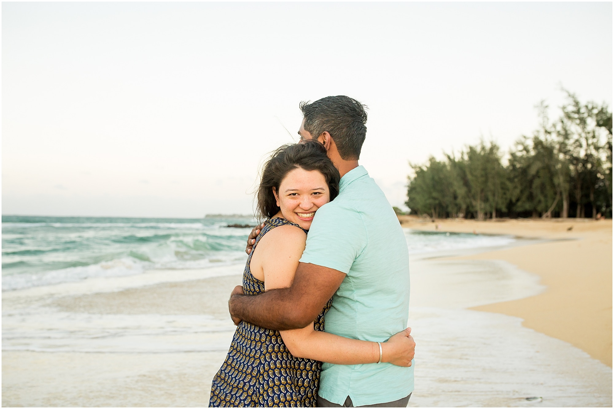 embracing after Maui proposal on north shore Maui beach