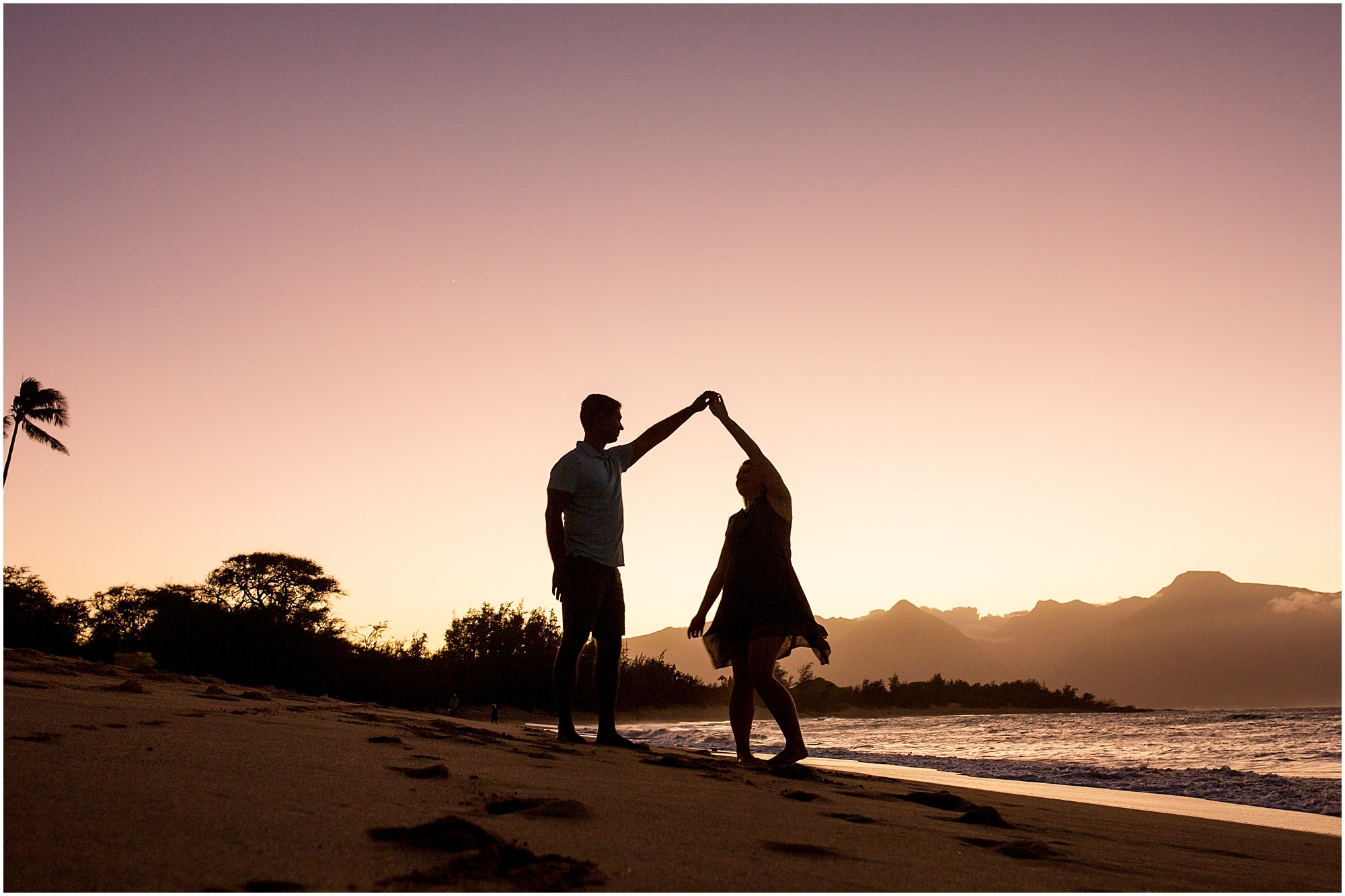 silhouette of couple dancing on the beach during Maui sunset