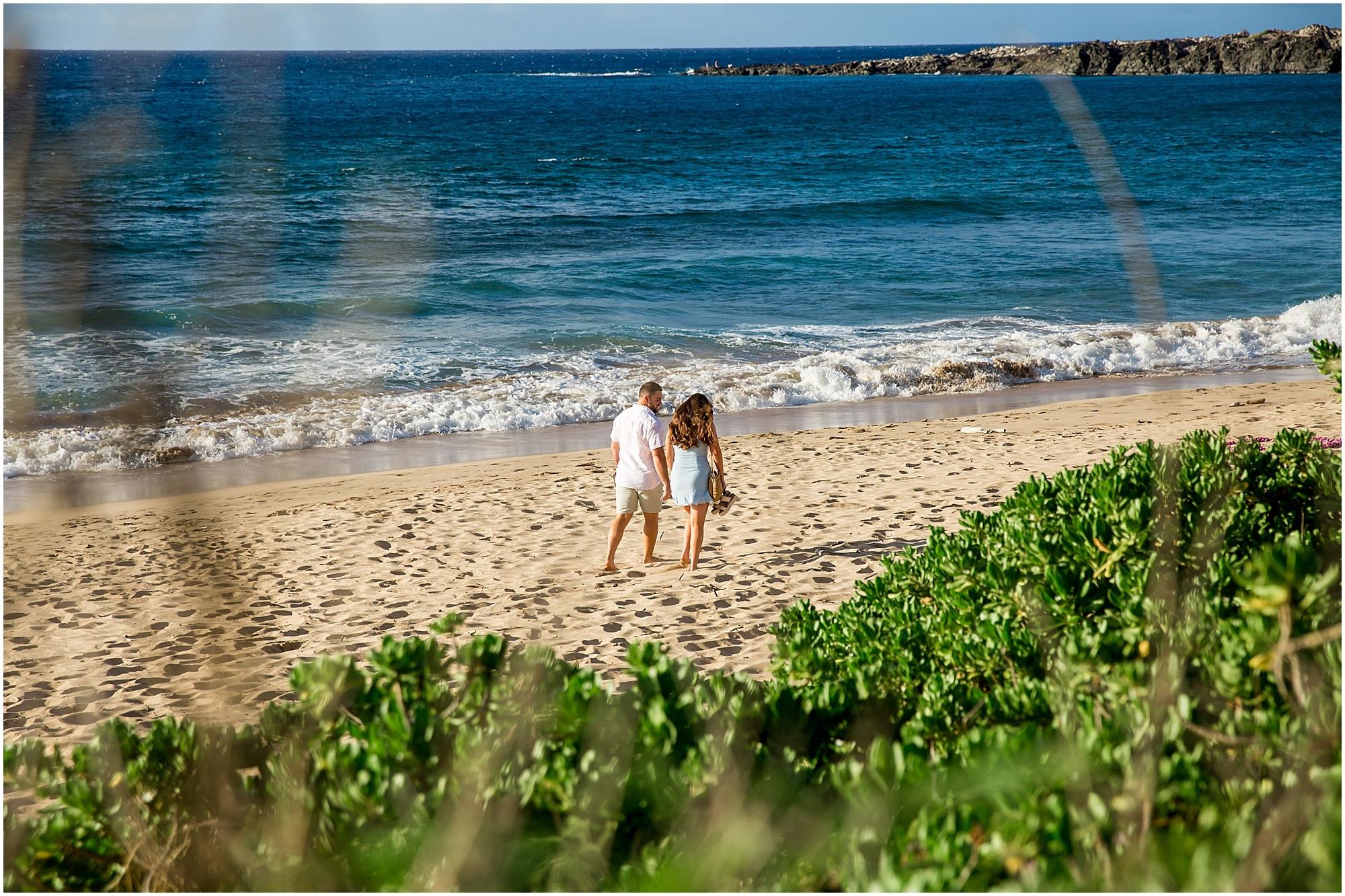 Couple walking to proposal spot