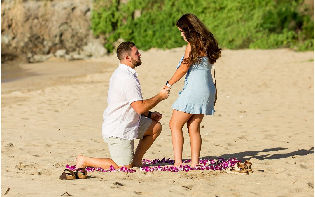 Romantic beach proposal with flower circle