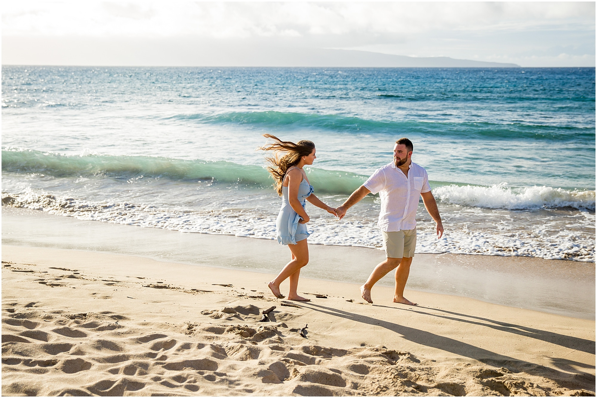 Strolling the beach during Maui engagement photos