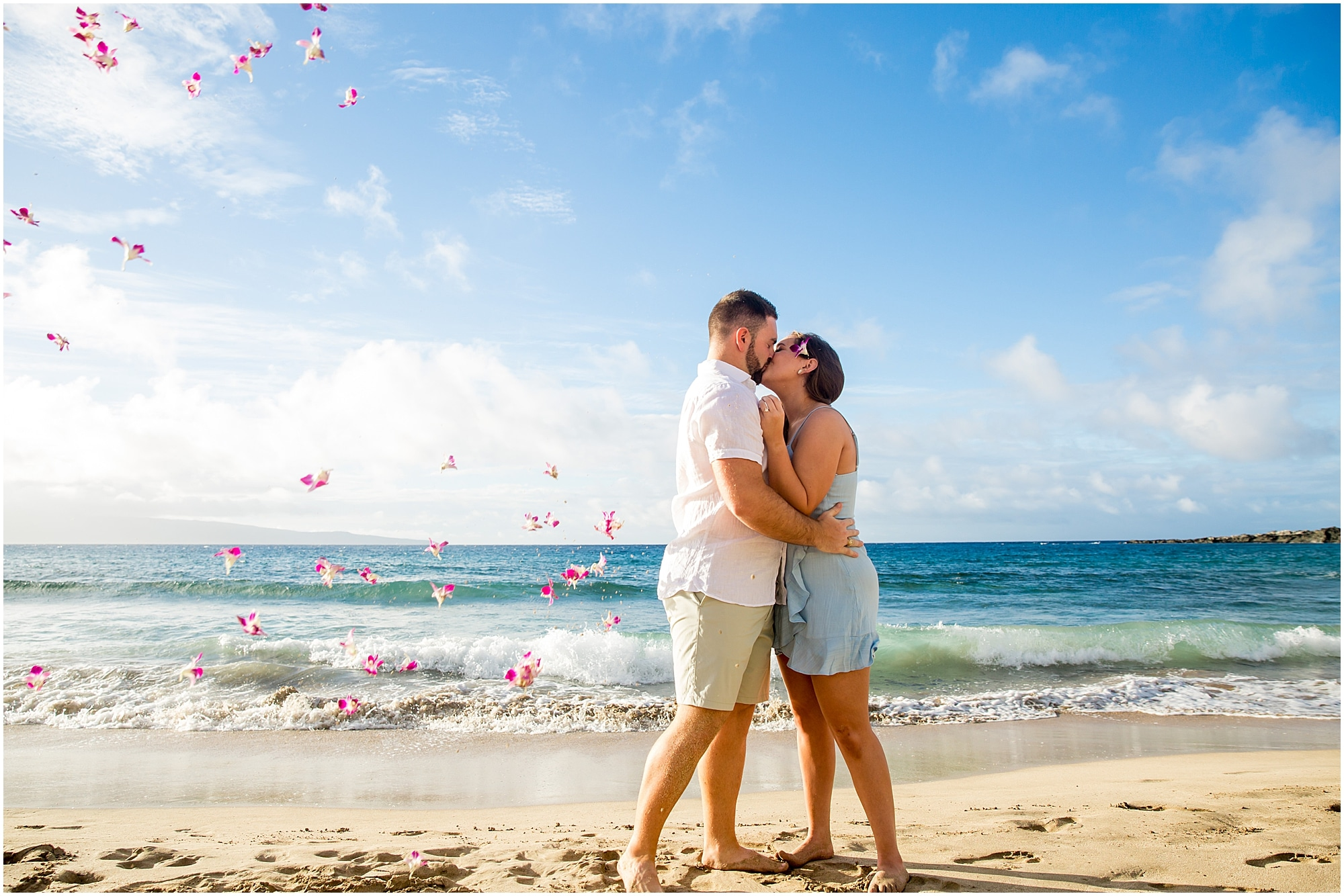Being showered with flowers during Maui engagement session