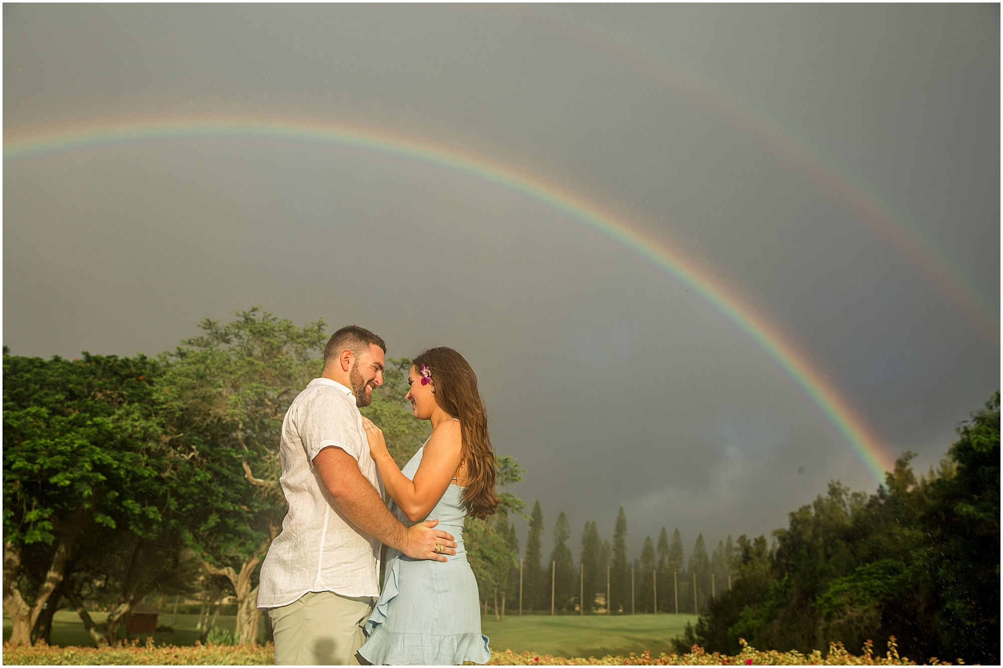 A double rainbow showed up during this Maui engagement session