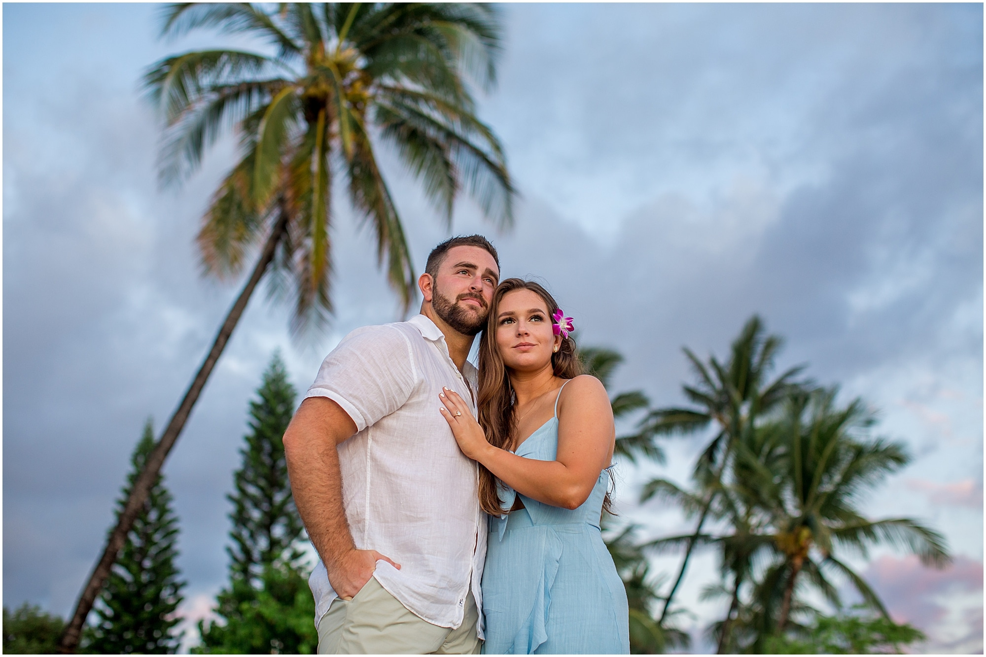 Couple posing under the palm trees